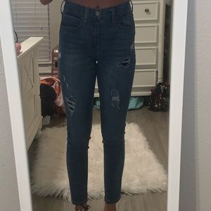 patched mid rise skinny jeans